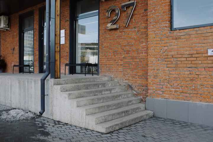 Concrete Steps and brick exterior walls